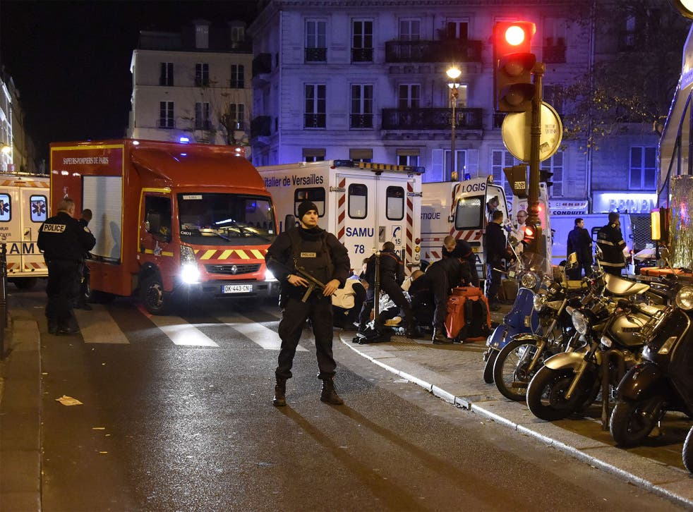 Police stand guard near the Bataclan concert hall