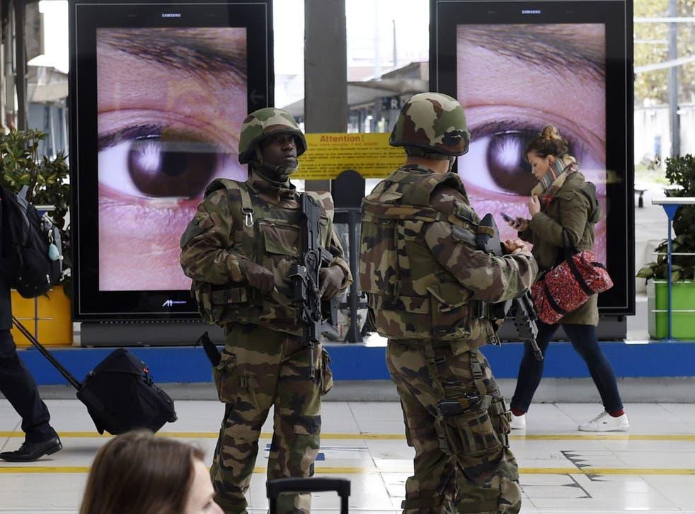 Police patrol the Austerlitz train station in Paris
