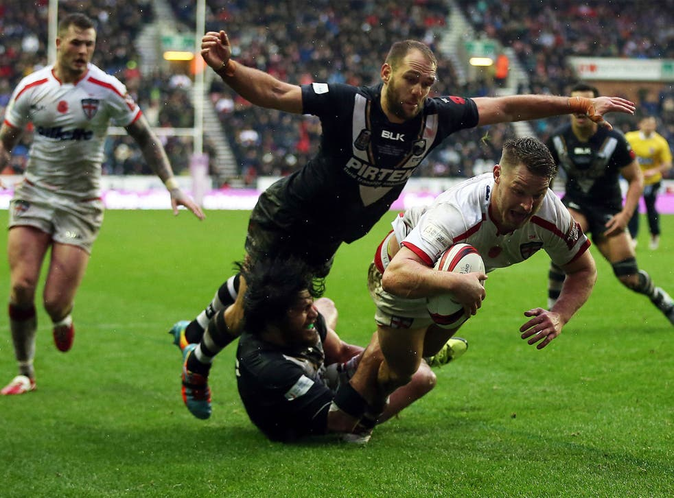 England's Elliott Whitehead scores a try against New Zealand