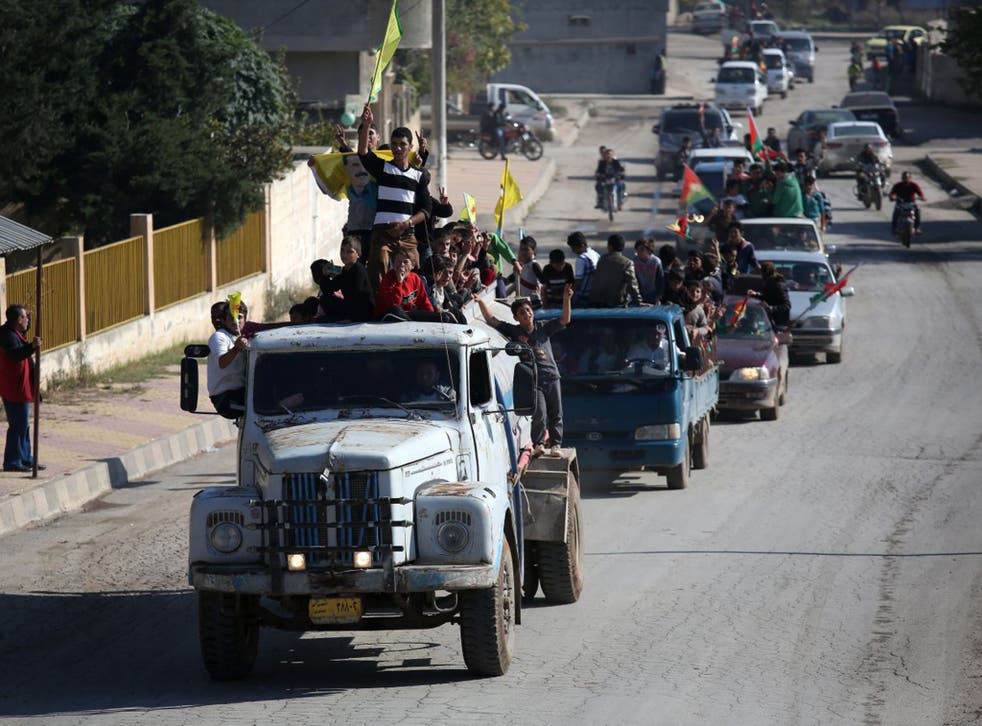 Yazidi refugees celebrating news of the liberation of their homeland of Sinjar from Isis extremists