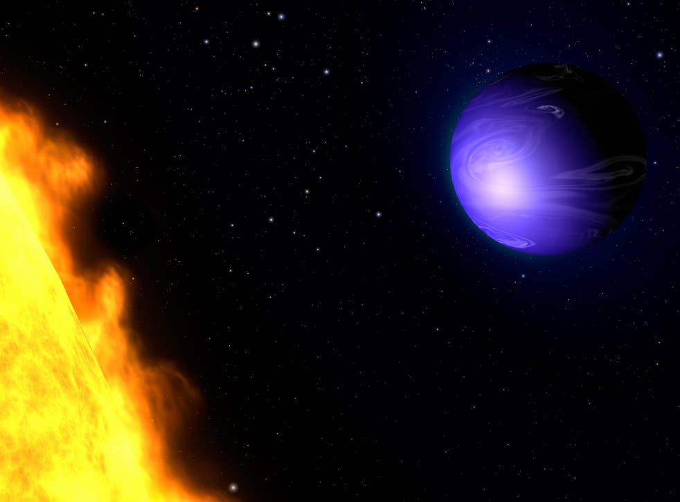 This artist's concept shows exoplanet HD 189733b orbiting its yellow-orange star, HD 189733.