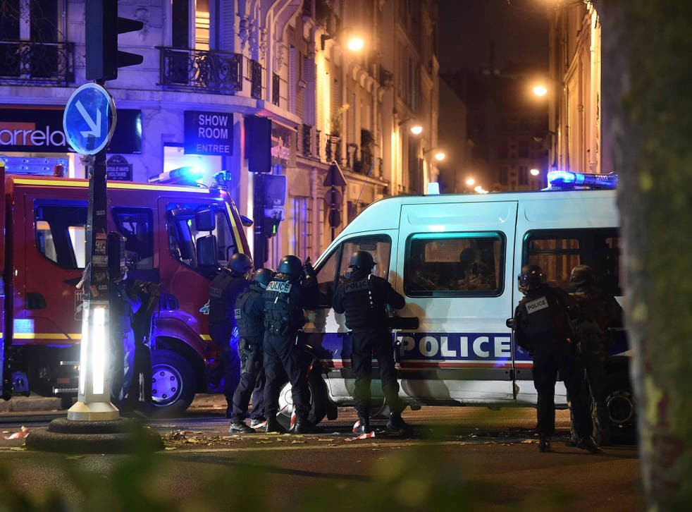 Police officers gather outside the Bataclan concert venue
