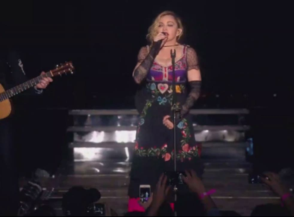 Madonna stopped a concert in Stockholm on Saturday to respond to the tragedy