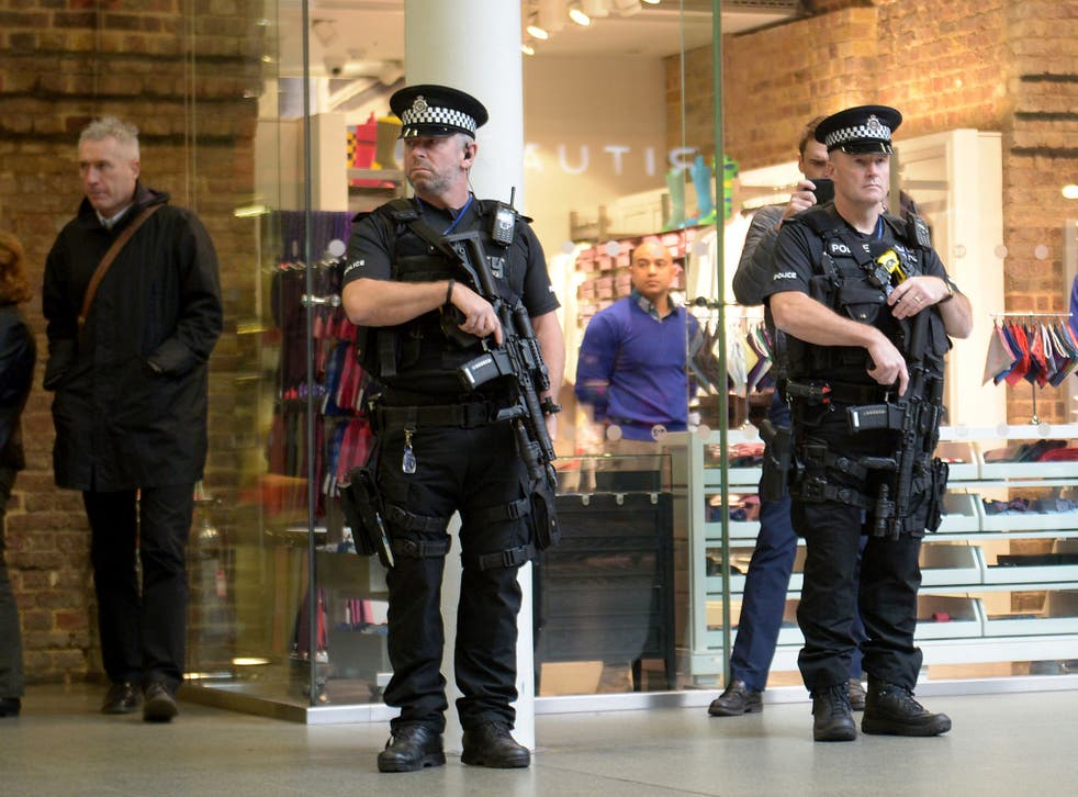 Armed police at St Pancras International Station in London