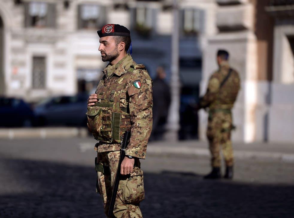 Italian soldiers patrol near the San Giovanni Basilica in Roma on November 16, 2015