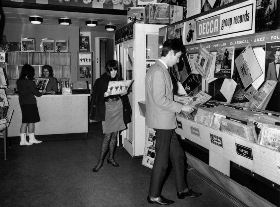 The way we were: teenagers looking at the latest albums in a record shop, 1965