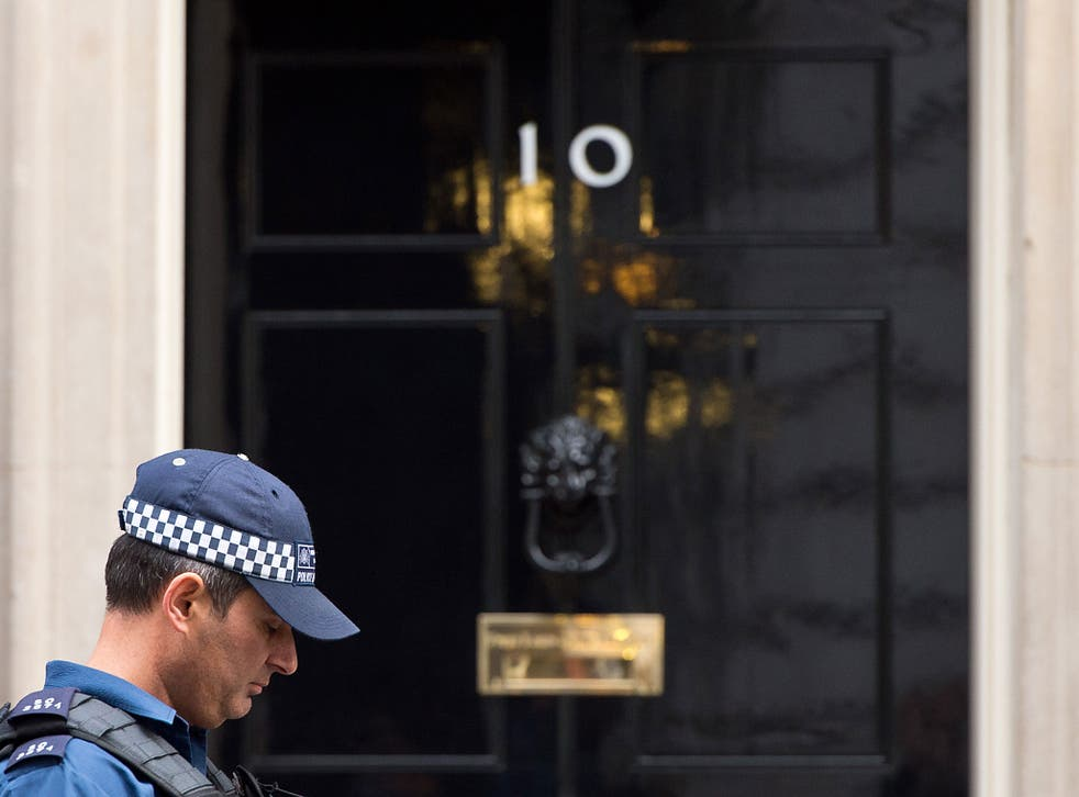A policeman stands outside Number 10 Downing Street on November 16, 2015 in London, England. Security in London has tightened after a series of terror attacks across the French capital of Paris