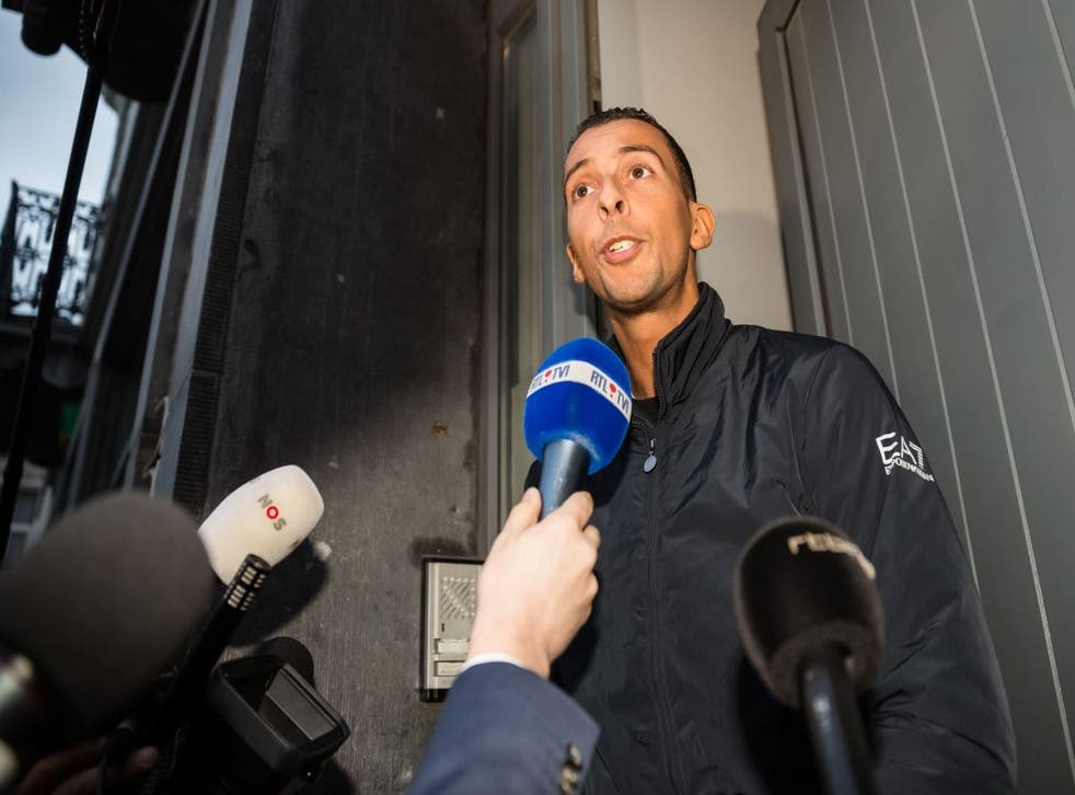 Mohamed Abdeslam, brother of fleeing Paris suspect Salah, speaks to reporters after being released from police custody