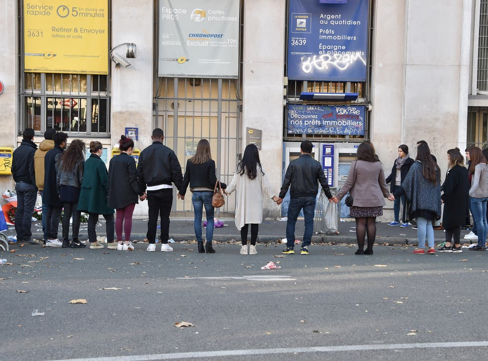 Mourners gathered outside the Bataclan concert hall in Paris