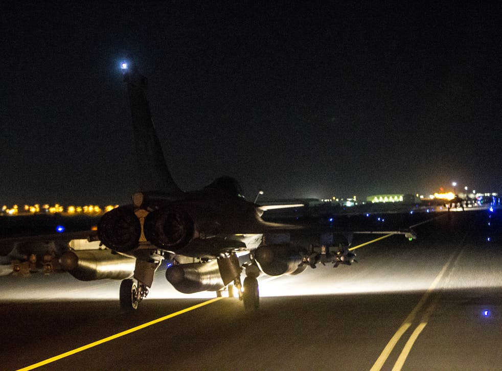 """A French army jet at an undisclosed air base in support of the US-led coalition against Isis in September. France has now launched """"massive"""" air strikes on the city of Raqqa"""