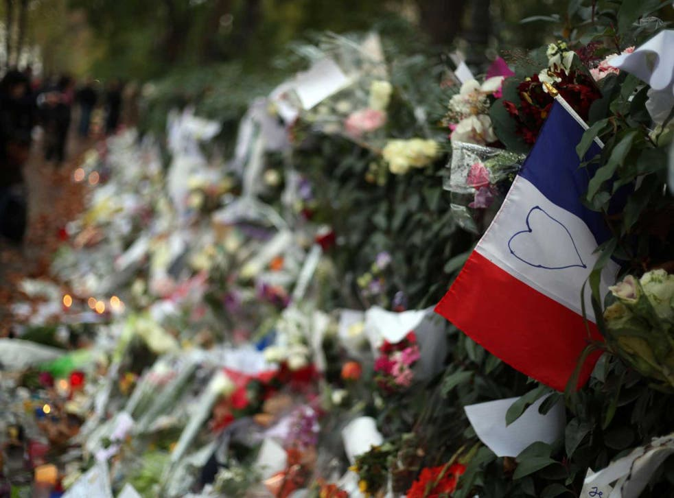People leave tributes to the victims of the Paris attacks