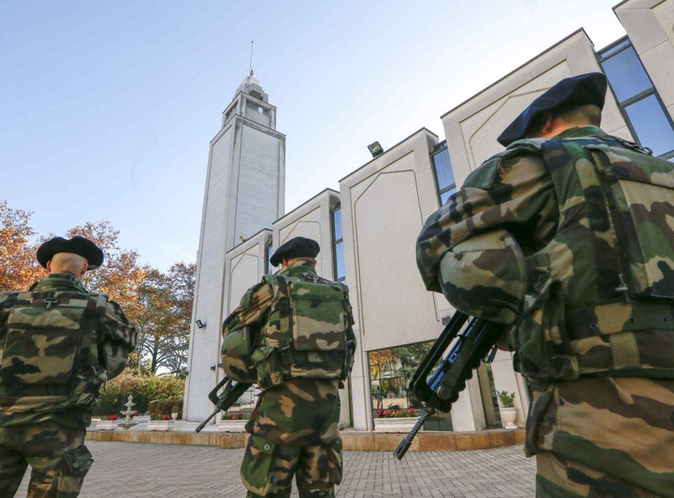 French paratroopers patrol outside the Great Mosque in Lyon