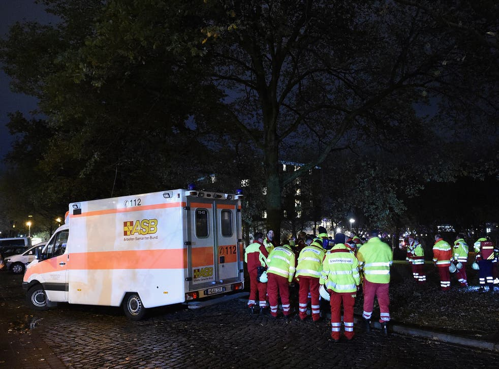 Emergancy service staff wait near an ambulance after the cancellation of the International friendly match between Germany and The Netherlands