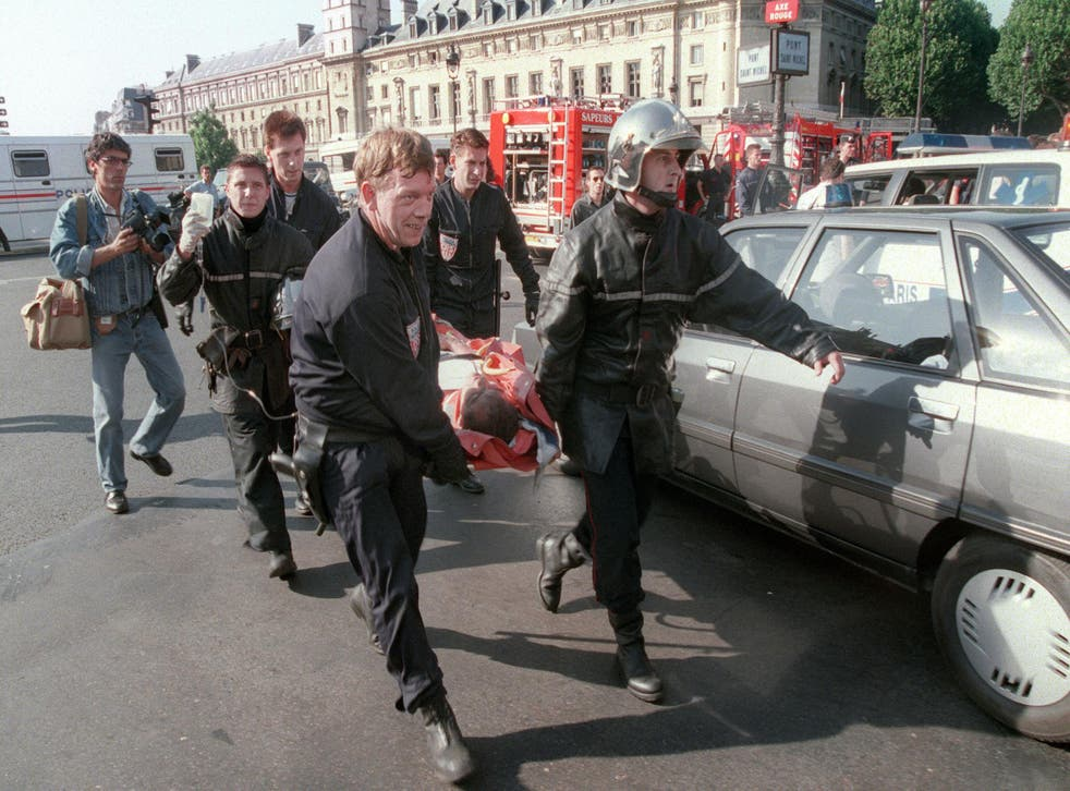 Firemen carry a victim of an Islamist bombing at Saint-Michel station in Paris in 1995 AFP/Getty