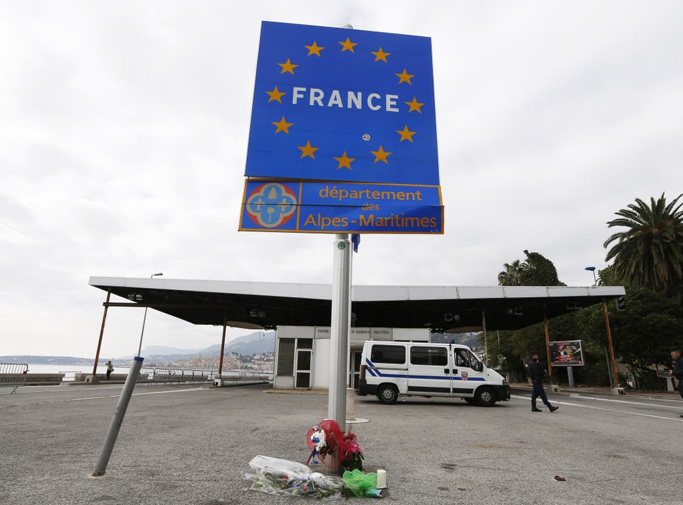 French police stand at the Franco-Italian border in Menton, south eastern France