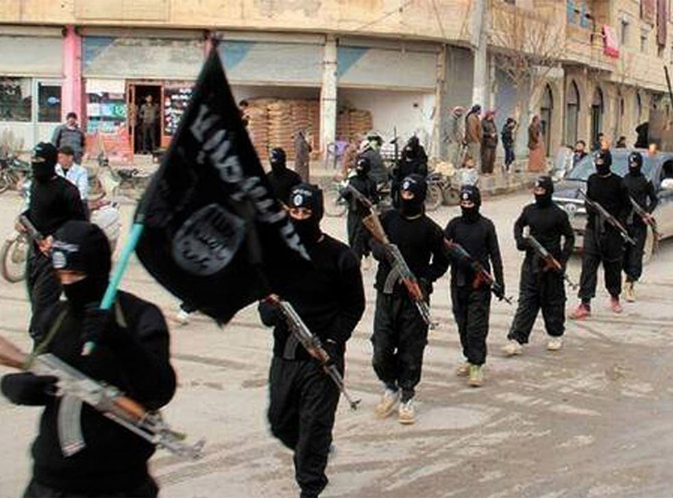 Isis fighters marching in Raqqa, Syria