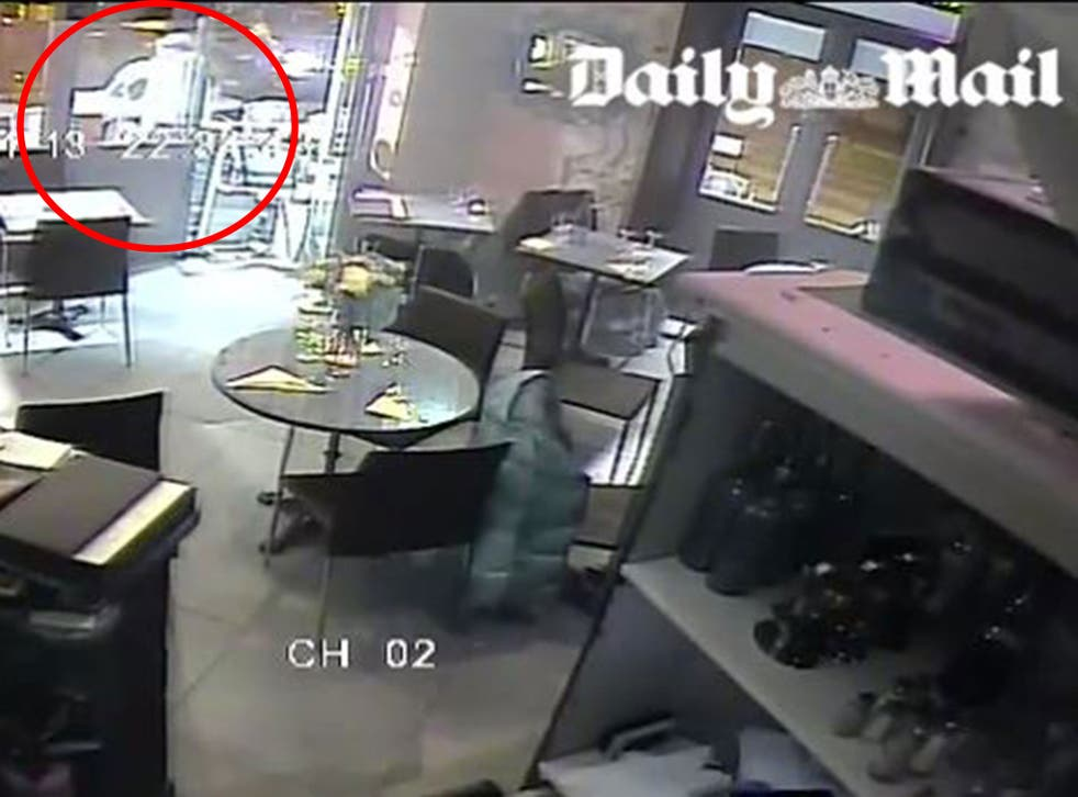 Dramatic CCTV footage shows one of the Paris gunman aiming point-blank at a woman (not seen). His gun appears to jam, and the woman runs away