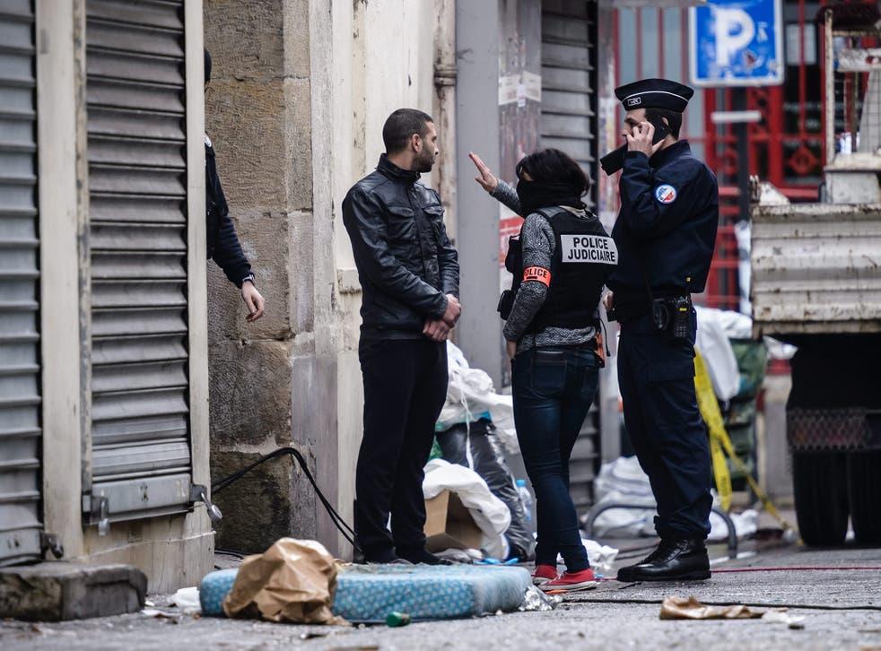 French police outside the Rue du Corbillon building in Saint-Denis