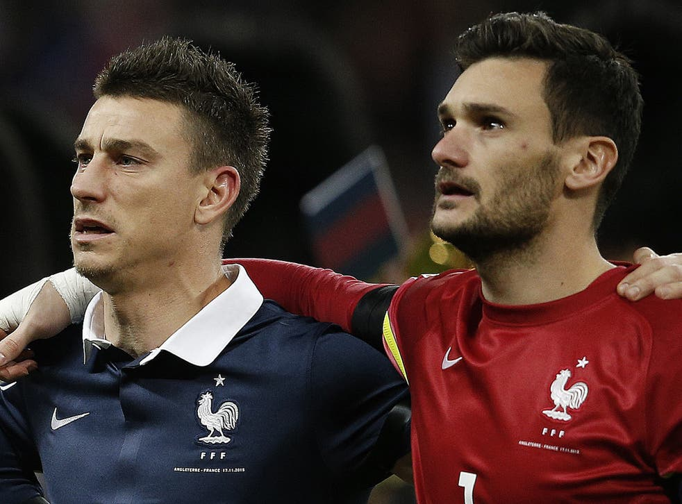 Laurent Koscielny, left, was visibly moved by the rendition of 'La Marseillaise' before Tuesday's match against England