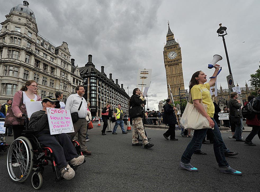 Disabled protestors demonstrate past the Houses of Parliament in 2011