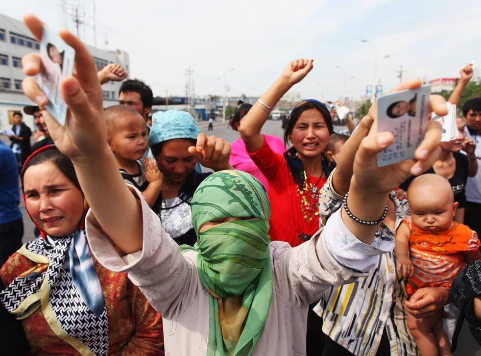 Uighur women protest against the Chinese government in Urumqi, the capital of Xinjiang Uighur autonomous region