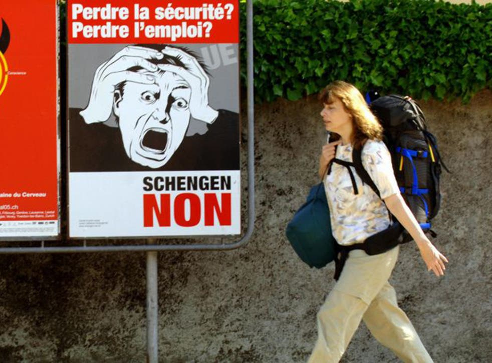 Posters advertising a referendum poster on the Schengen treaty in Nyom