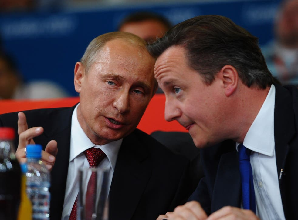Vladimir Putin watching Judo with David Cameron on Day 6 of the London Olympic Games in 2012