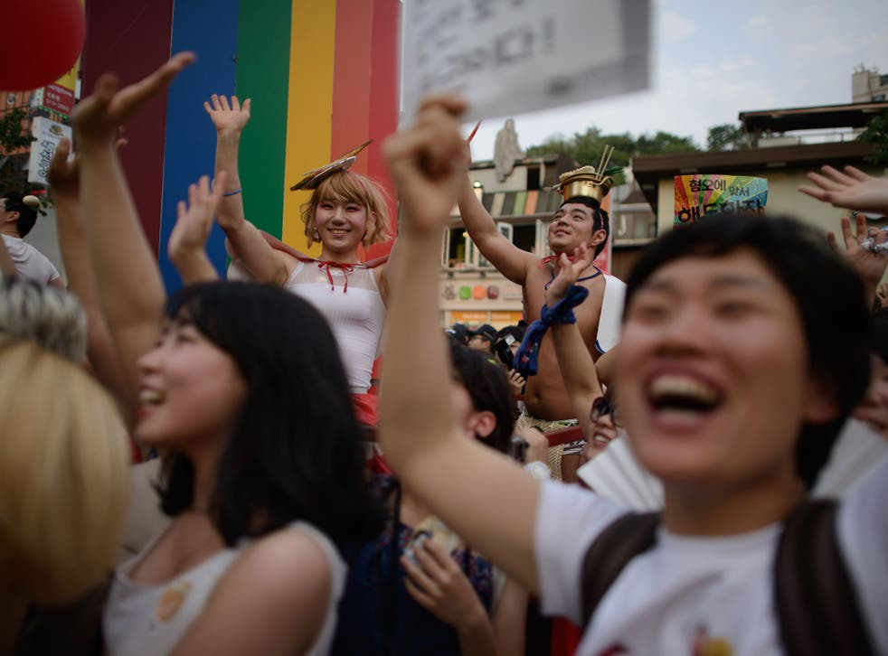 Members of the LGBT community take part in a Gay Pride parade in Seoul. Many younger Koreans preach tolerance and equality
