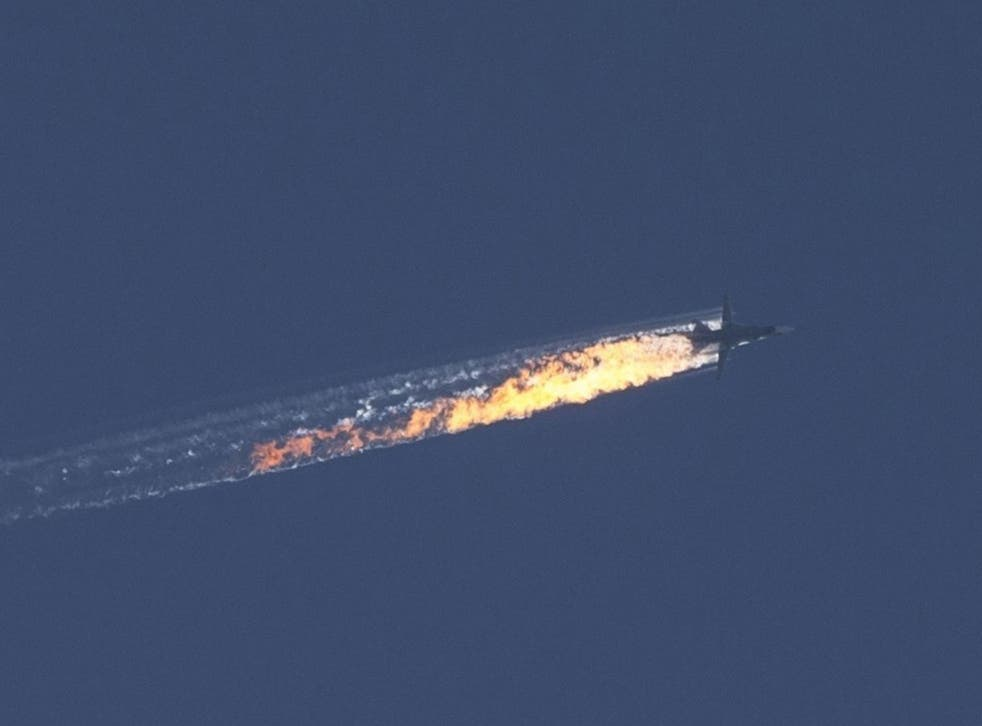 A trail of flames is seen behind the jet after it was struck by the Turkish military