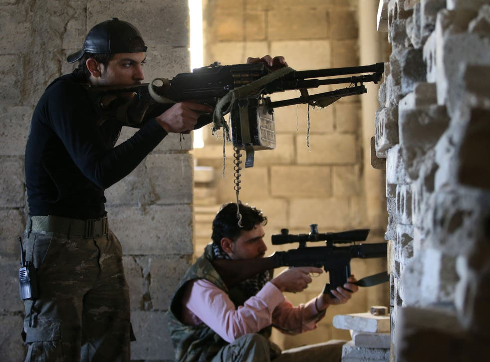 Free Syrian Army fighters take on the Syrian military in the town of Maarat al-Nuaman
