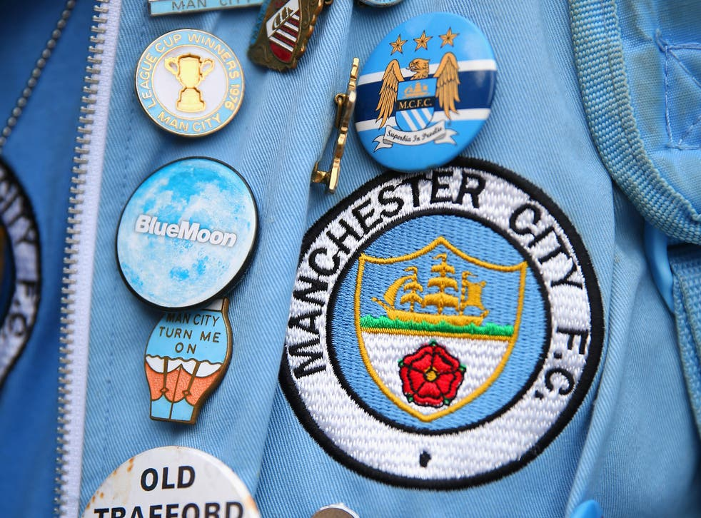 Manchester City's former badge (main), used between 1972 and 1997, with the club's current badge featuring above