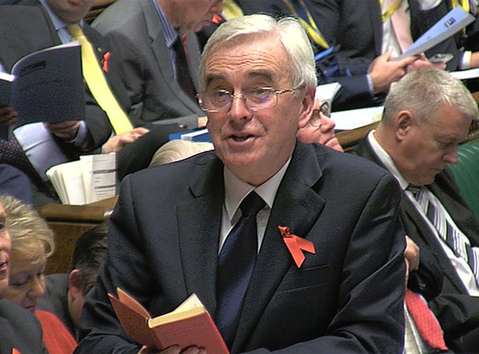 Shadow chancellor John McDonnell reads a passage from the Little Red Book