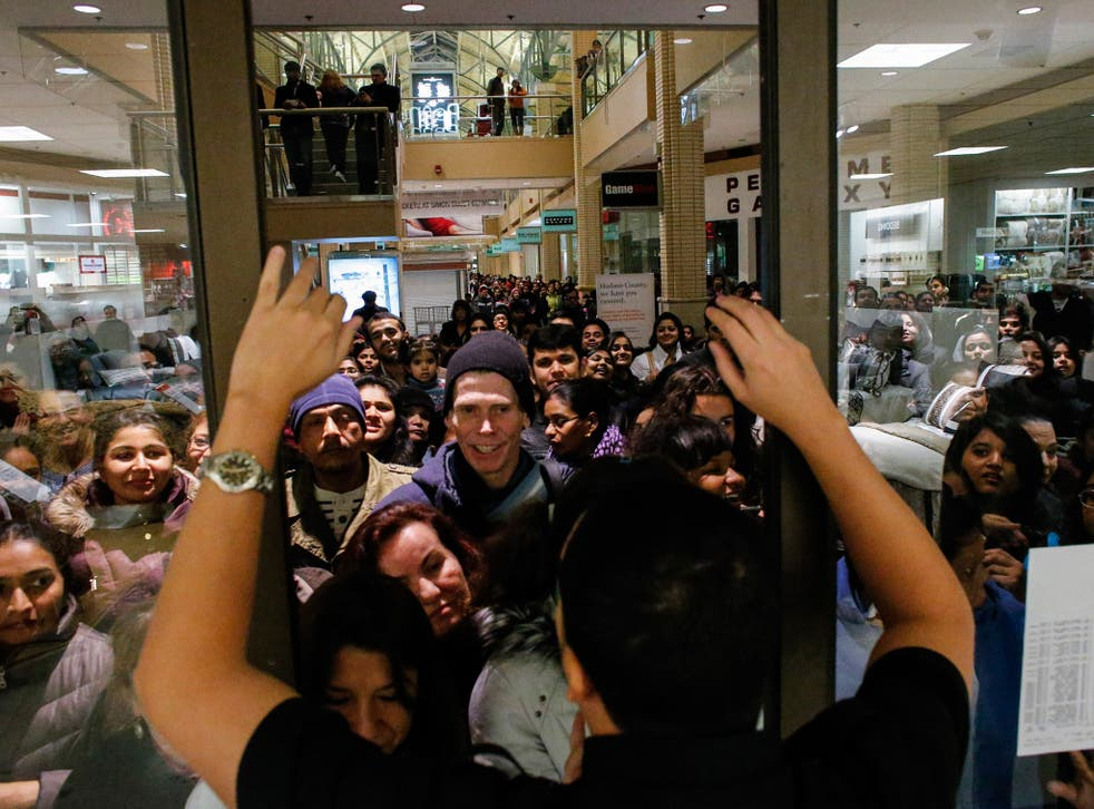 People waits in line to go shopping at the to JCPenney store at the Newport Mall on 2014's Black Friday
