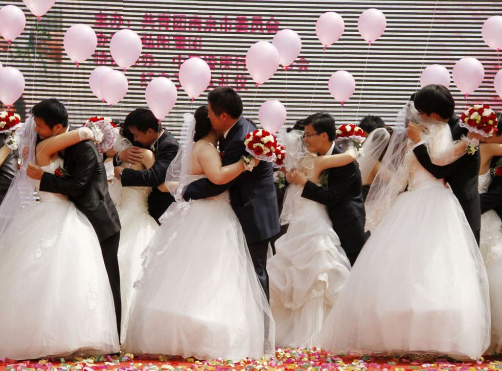 A May Day mass wedding in Nanjing. Thousands of 'heterosexual' marriages are in fact a front for gay couples in China
