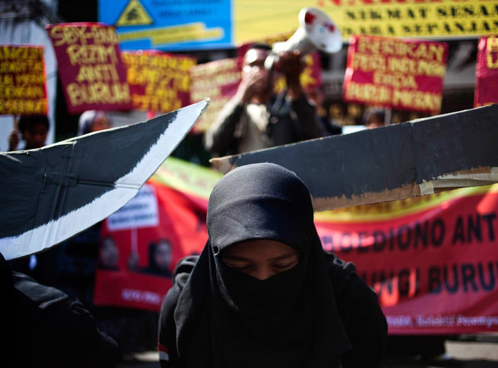 Indonesian protesters demonstrate after the execution of an Indonesian maid in Saudi Arabia