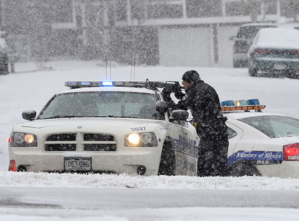 An officer waits after reports of a shooting near a Planned Parenthood clinic Friday, Nov. 27, 2015, in Colorado Springs,
