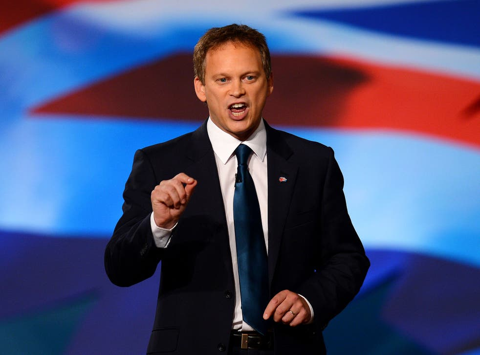 Co-Chairman of the Conservative Party Grant Shapps gestures as he speaks during the opening day of the annual Conservative Party Conference at the ICC in Birmingham, central England on October 7, 2012.