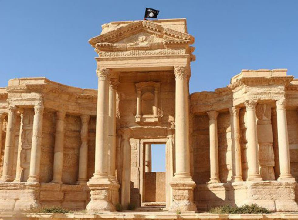 An Islamic State flag flies over the Roman theatre in Palmyra. The group have now been driven from the site.