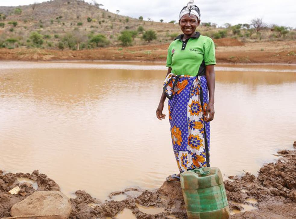 Tabitha Paul stands next to the incomplete Musosya dam in Musosya village, Kitui
