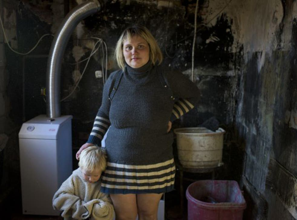 Single mother of five Natalia Svergun in her home, which has been gutted by shell fire