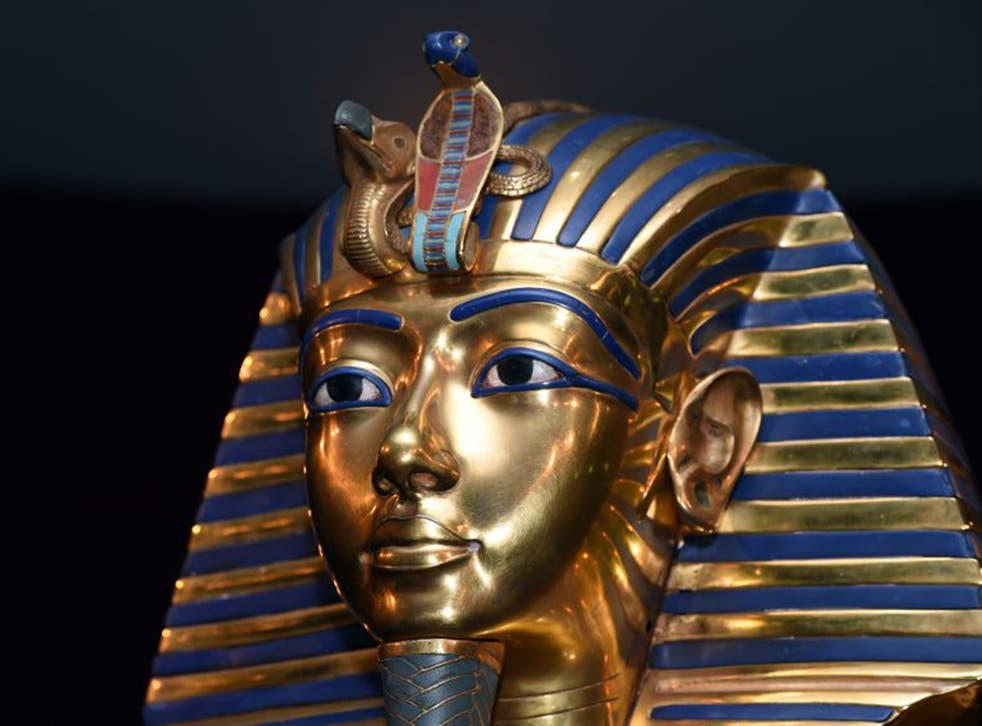 Hieroglyphics on the mask appear to have been inscribed on top of earlier writing