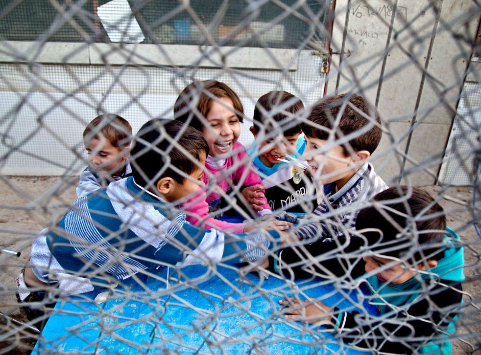 Syrian refugee children play at a temporary refugee camp in Irbil, northern Iraq