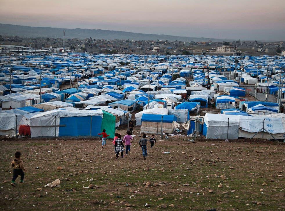 Syrian refugee children run at a temporary refugee camp in Irbil, northern Iraq.