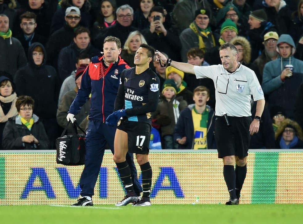 Alexis Sanchez limps off at Carrow Road