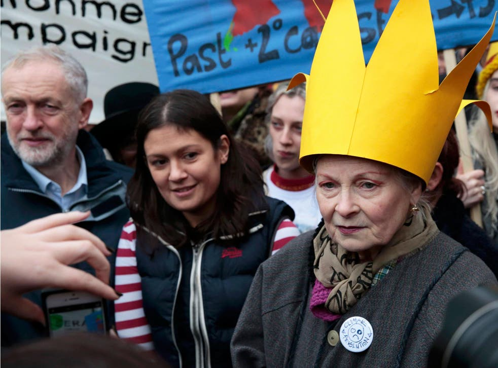 Britain's leader of the opposition Labour Party, Jeremy Corbyn (L), and fashion designer Vivienne Westwood (R) attend a rally held the day before the start of the Paris Climate Change Summit, in London