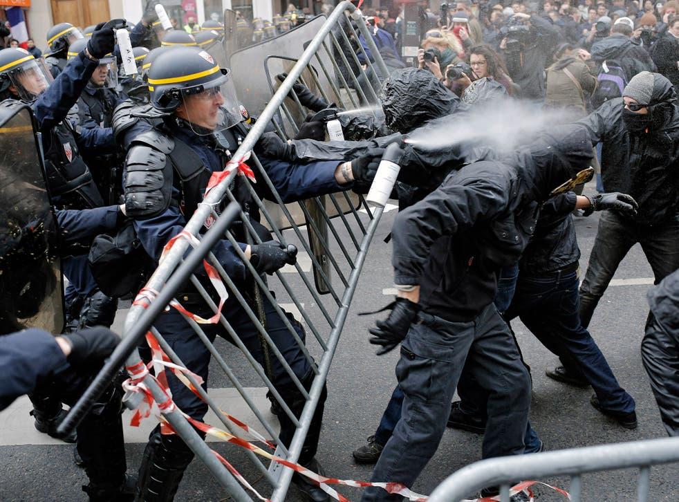 Policemen fight with climate change activists at the Place de la Republique in Paris