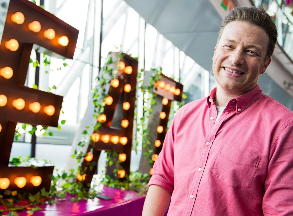 TV chef Jamie Oliver championed a drive for labels indicating spoonfuls of sugar in fizzy drinks