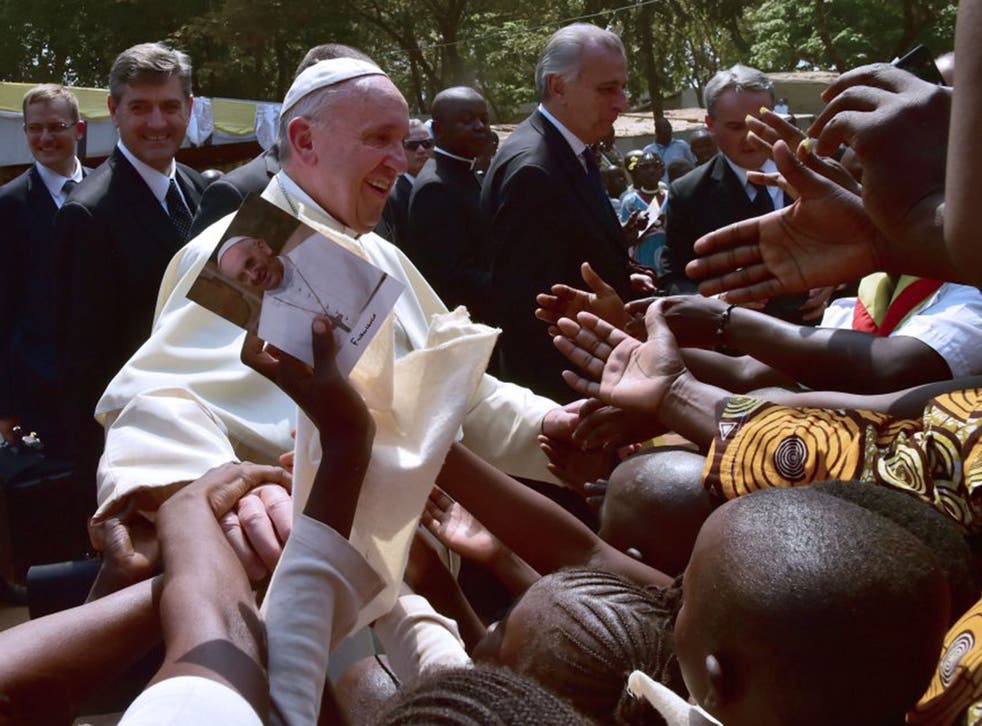 Pope Francis visits a refugee camp in Bangui on his current tour of Africa