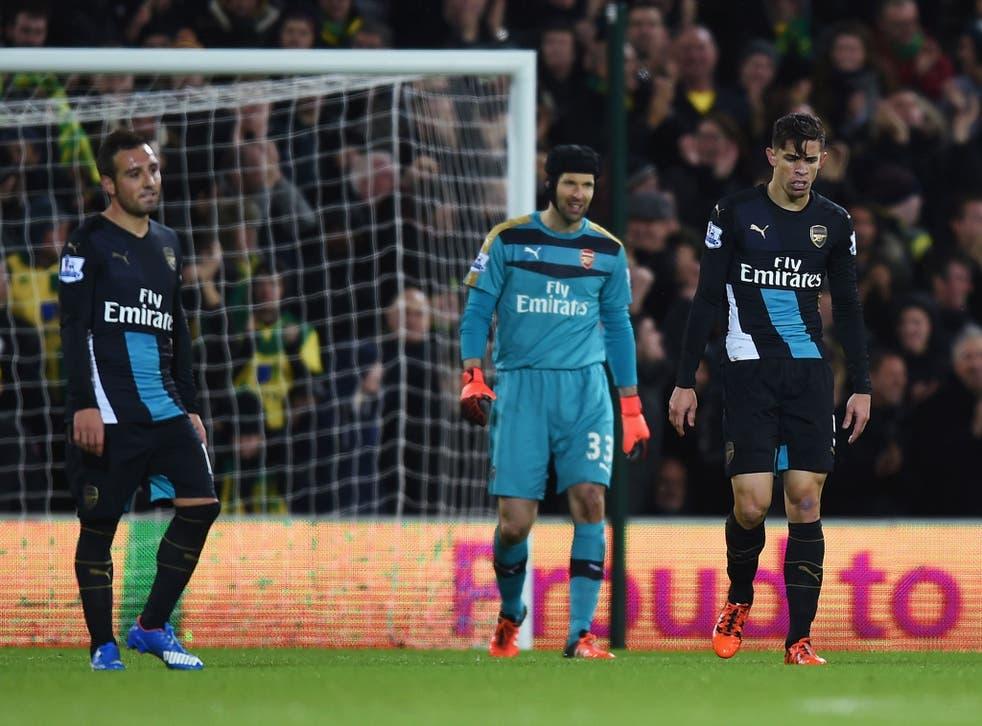 Santi Cazorla, Petr Cech and Gabriel Paulista react to conceding a goal against Norwich