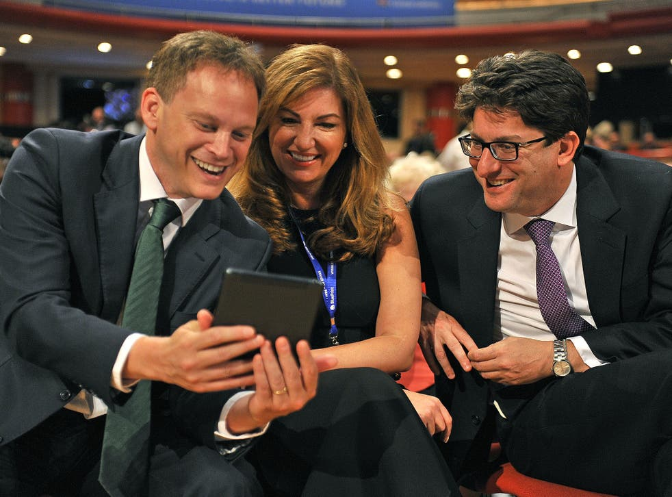 Grant Shapps, left, with Lord Feldman (pictured with Karen Brady, centre) at the Tory conference in 2014